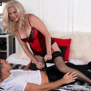 Aged sandy-haired dame Val Kambel entices a younger boy in tempting lingerie and tights