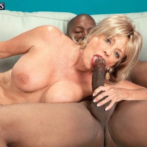 Fair-haired grandmother Lexi McCain baring huge knockers before delivering BIG BLACK COCK blow job