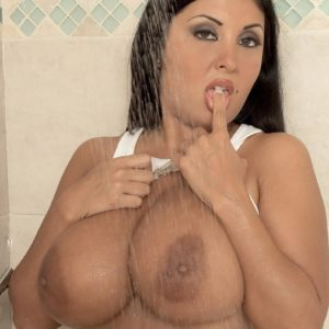 Latina MILF Daylene Rio whips out her immense breasts from moist t-shirt and brassiere