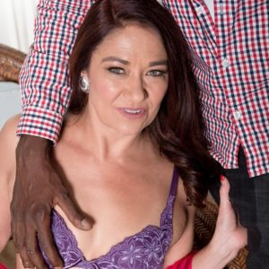 Magnificent elder woman Renee Black takes off her lingerie for a black dude