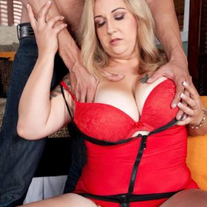Platinum-blonde BIG SEXY WOMAN Dani Moore uncovers her large funbags before providing a blow-job in lingerie