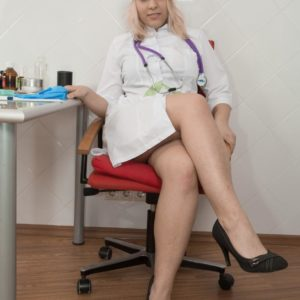 Sandy-haired nurse Jill unzips in her work environment to display her unshaven beaver in high-heeled shoes