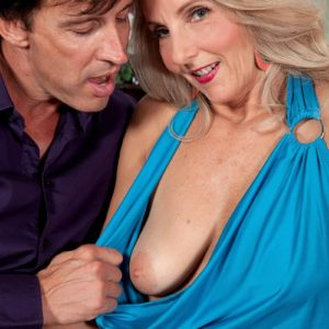 Senior ash-blonde broad Chery Leigh unsheathes her melons in tan hosiery for her husband