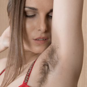 Solo model Donatella showcases off her unshaven underarms and pussy in nude modelling debut