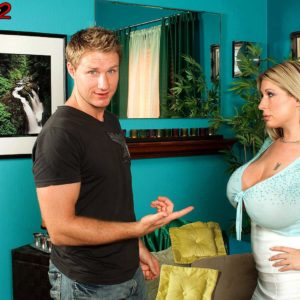 Blond assistant Summer Sinn showcases her enormous breasts at the office place in a lengthy mini-skirt