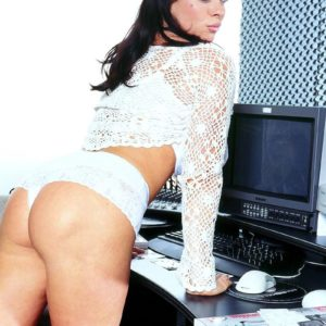 Brunette MILF Linsey Dawn McKenzie unveils her monster-sized titties at her office desk