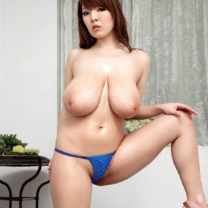 Chinese MILF Hitomi looses her monster-sized boobies from her bathing suit top in pumps