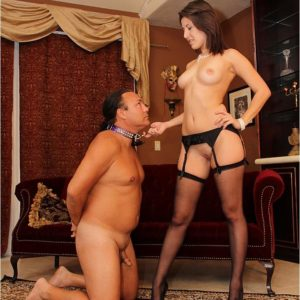 Dark-haired wife Missy Daniels puts a collar on her masculine sub and tramples him