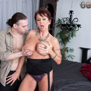 Elegant aged gal Gina Milano seduces a younger man with her large tits