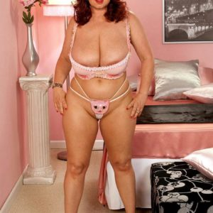 Ginger-haired chubber Cherry Brady struts in her bra and panty ensemble and rosy high heels