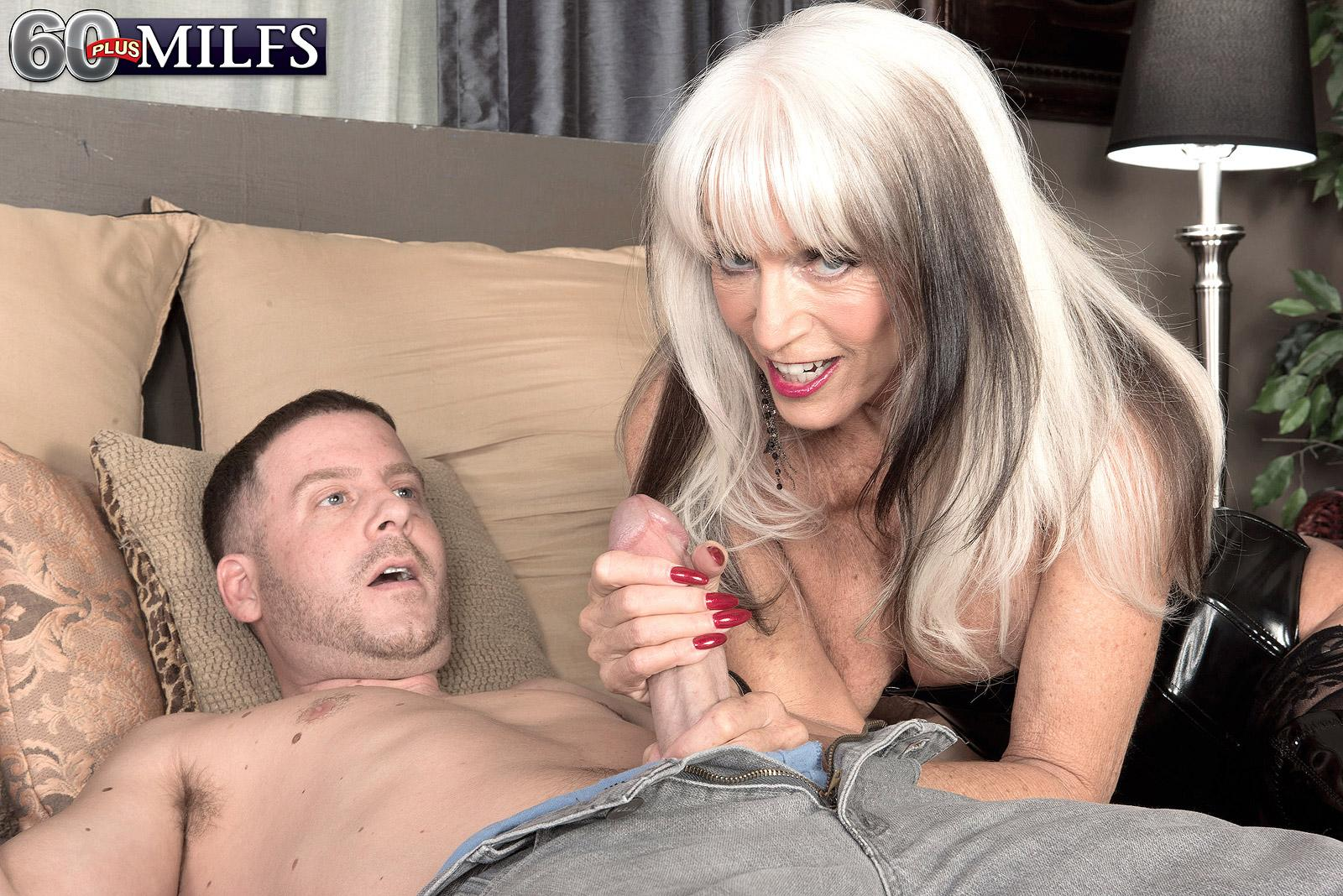 Hefty titted 60 plus MILF Sally D'Angelo jacks a boner in latex boots and black corset