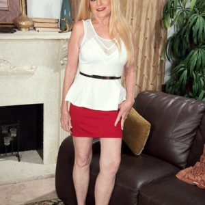 Senior platinum-blonde gal Charlie has her giant hooters exposed by junior man in a crimson skirt