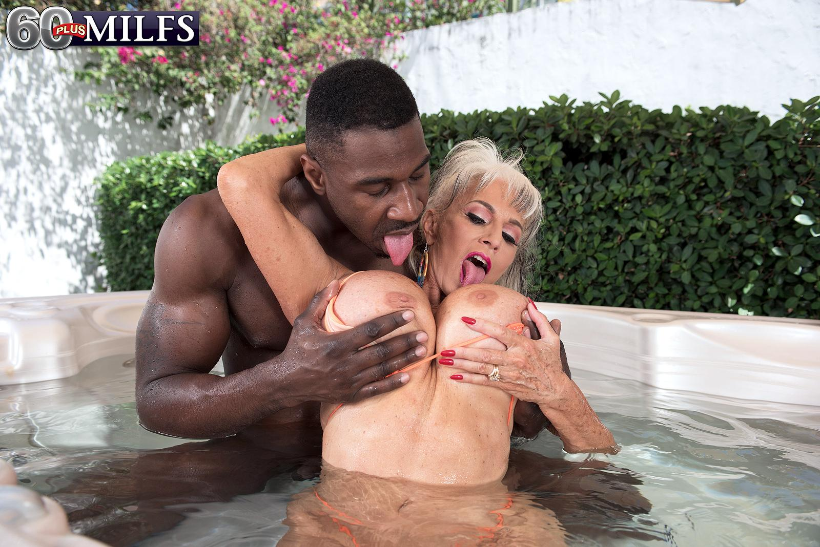 Sex grannie Sally D'Angelo and her hefty fun bags take on a BBC outdoors in a Jacuzzi