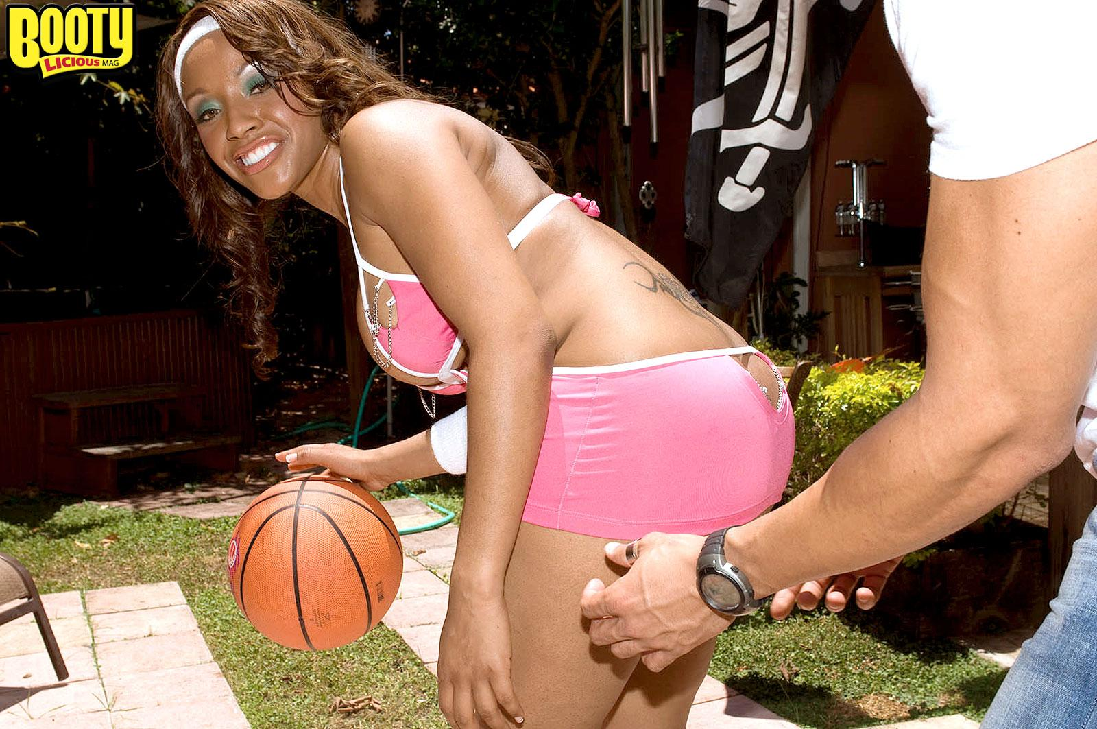 Black chick Ayana Angel flaunts her massive arse in a short micro-skirt while dribbling a basketball