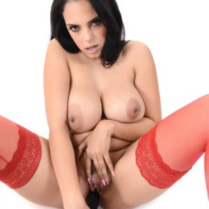Dark haired solo model Katrina Moreno reveal her funbags outfitted in red tights