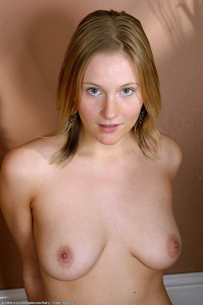 Fair-haired solo female with humungous all-natural melons showcases her fur covered bush while strutting naked