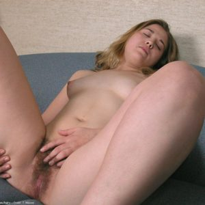 First-timer model pulls down her panties preceding to masturbating her fur covered muff