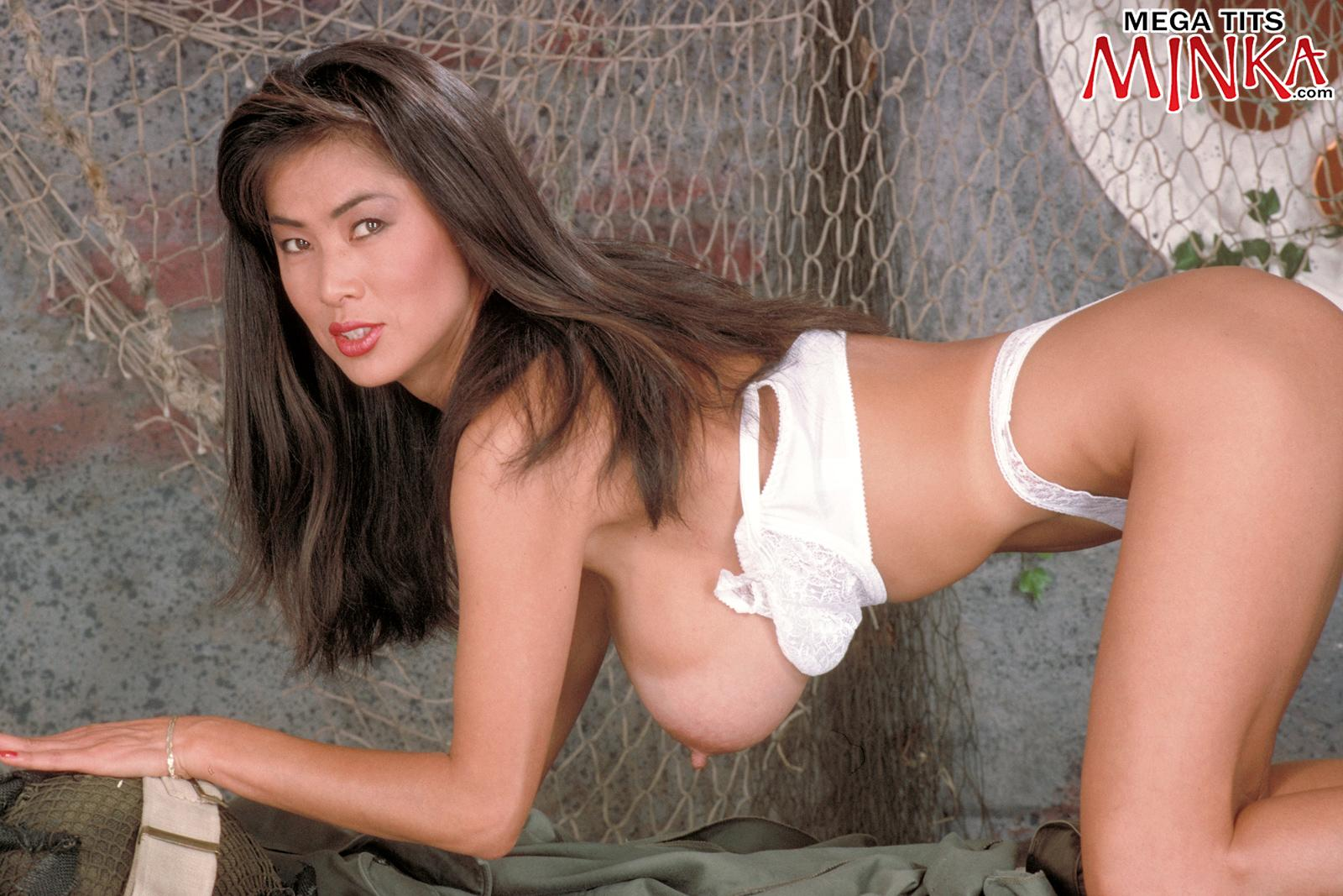 Oriental solo model Minka bares her gigantic tits from her bra army fatigues