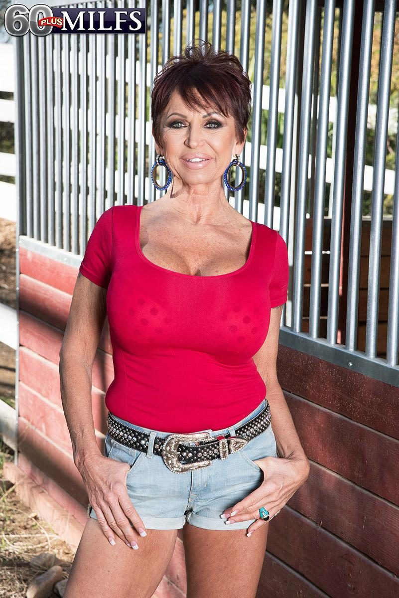 Over sixty woman Gina Milanos entices a youthful boy with her immense juggs in denim shorts