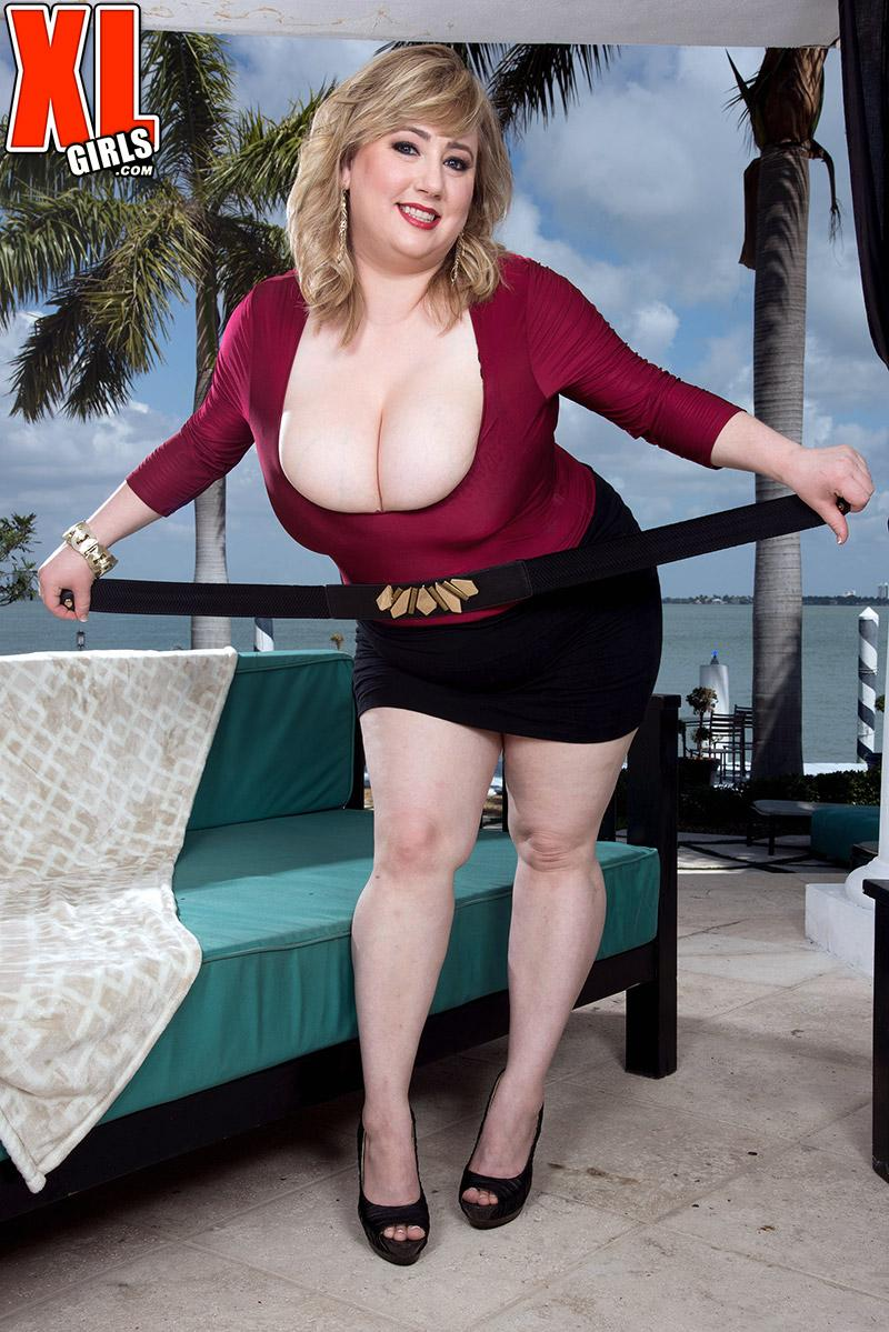 Over weight blond girl Laddie Lynn flashes her upskirt skivvies along with her ample cleavage
