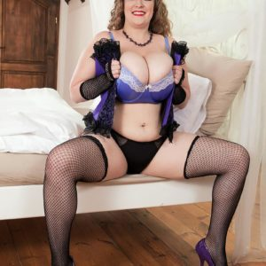 Plus sized solo model Smiley Emma reveals her hefty breasts in fishnet hosiery and arm socks