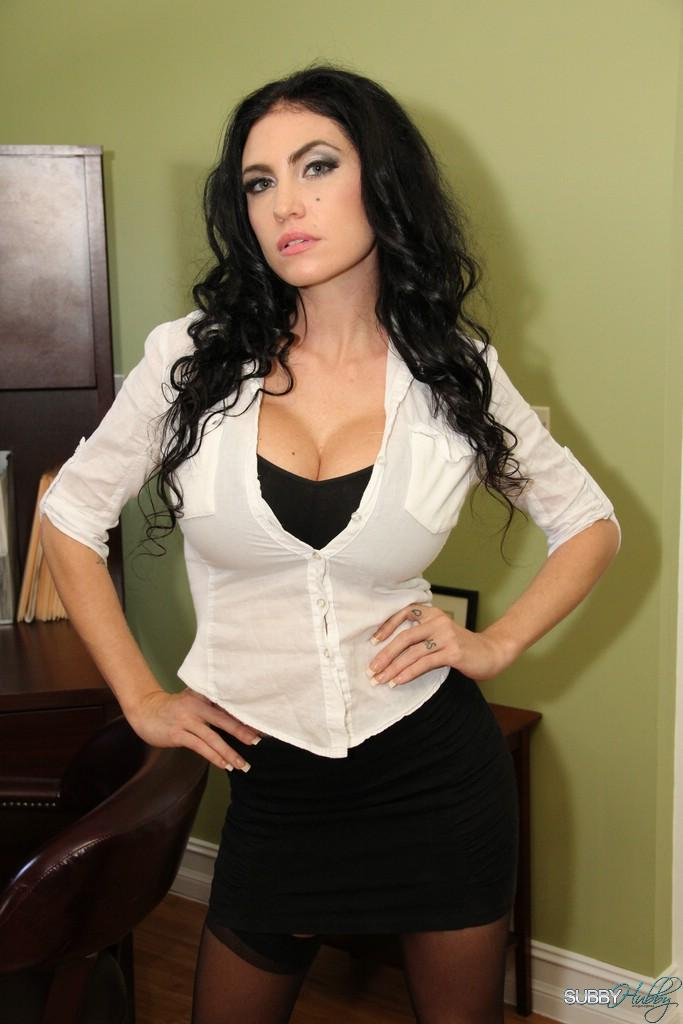 Seductive black-haired chick Emmanuelle London does away with her skirt to reveal her smoothly-shaven cootchie