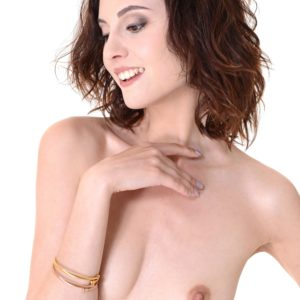 Solo model Sade Mare stuffs a hefty bang stick into her bald cootchie after undressing naked