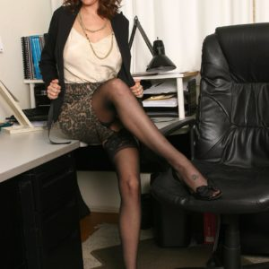 Super-sexy senior broad strips to her black tights only in her home office place