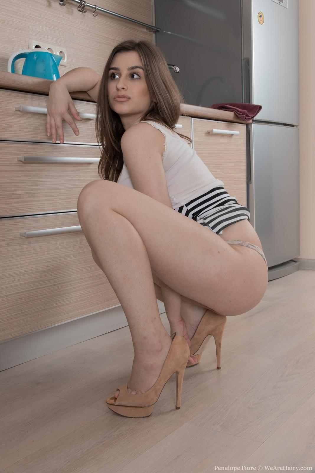 Amateur solo female Penelope Fiore flaunts her hairy snatch in the kitchen