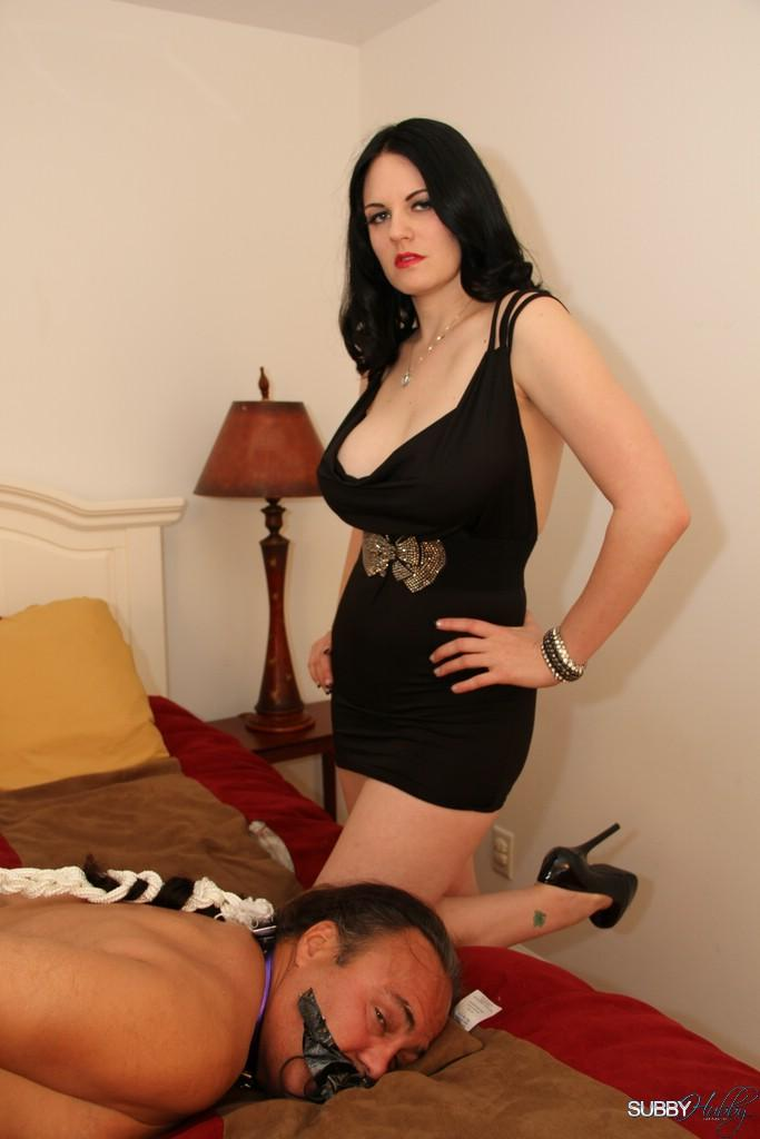 Dark haired wife Shae fatale hog ties her masculine before undressing to her lingerie and heels