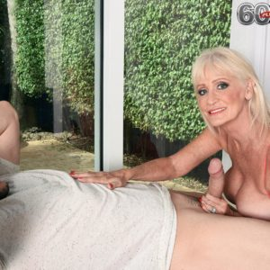 60 plus MILF Leah L'Amour tempts a junior boy at the door with her giant juggs out