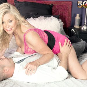 Alluring older doll Lauren Taylor seduces a junior stud in a rosy miniskirt