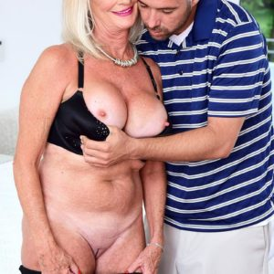 Fabulous grandmother Leah L'Amour deep-throats and pounds a monster-sized dick while her husband sleeps