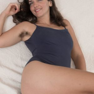 Hirsute brown-haired Katie Z takes off her onesie to make her naked posing debut outdoors