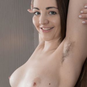 Limber first timer model Cherry Bloom shows her unshaven pits and unshaven cootchie in the au naturel