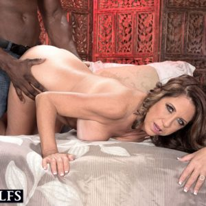 Mature gal Karen DeVille is undressed by a ebony guy before taking his BBC in hand