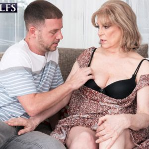 Older dame Crystal King has her gigantic juggs played with by a younger dude