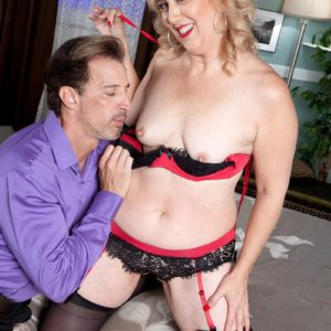 Older girlfriend with yellow-haired hair Rebecca Williams entices her hubby in lingerie and stockings