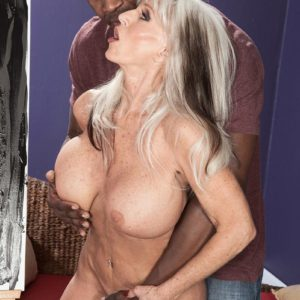 Big-boobed 60 plus pornstar Sally D'Angelo gets nailed by a younger ebony stud