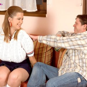 MILF Terry Nova has her huge boobies freed by guy mate from melon-holder in a micro-skirt and knee socks