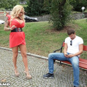 Blonde bombshell Bambi Blacks seduces a guy on a park bench in a short dress