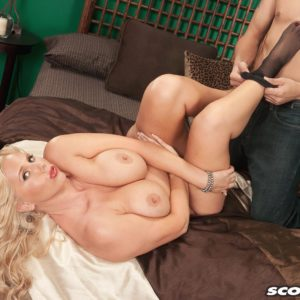 Mature blonde MILF Karen Fisher is stripped of her lingerie and hosiery by her lover