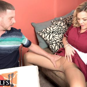 Mature blonde woman Lena Lewis seduces a younger boy after baking him a cake