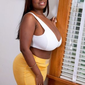 Ebony BBW Olivia Jackson hikes her miniskirt up and over her big ass in solo action
