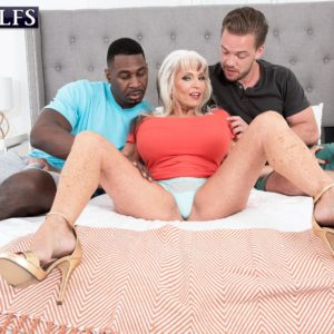 Hot 60 plus MILF Sally D'Angelo sucks on a BBC and a big white cock at the same time