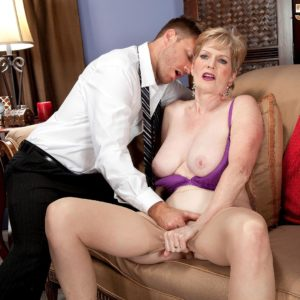 Mature woman Sindee Dix is stripped naked before blowing her younger lover