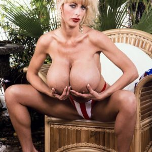 Famous pornstar Pandora Peaks releases her massive tits from a USA themed bikini