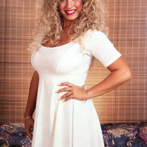Famous pornstar Taylor Marie unleashes her massive tits in a white dress and lingerie