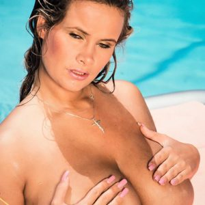 Solo model Trinity Loren shows off her huge boobs while taking a dip in the pool