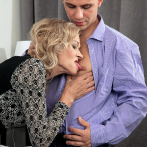 Foxy blonde granny Beata seduces a younger stud in a ebony micro-skirt and pantyhose